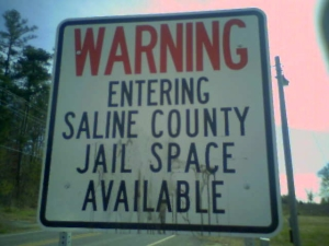 warning-entering-saline-county-jail-space-available-chicot-road-sign